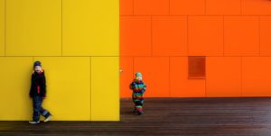 Steni yellow and orange facade with children