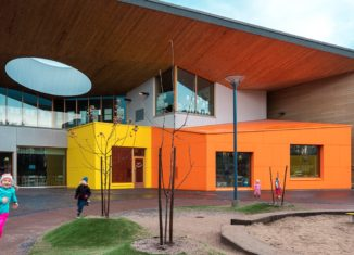 School yard with colorful facades in yellow and orange